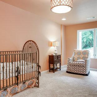 Cette photo montre une grand chambre de bébé fille chic avec un mur orange et moquette.