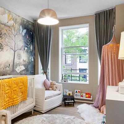 Nursery - transitional gender-neutral medium tone wood floor and brown floor nursery idea in New York with beige walls