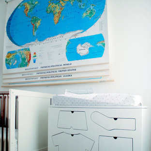 Inspiration for a medium sized eclectic nursery for boys in New York with white walls and dark hardwood flooring.