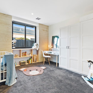 This is an example of a contemporary gender-neutral nursery in Melbourne with white walls, carpet and grey floor.