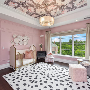 Nursery - mid-sized contemporary dark wood floor, brown floor, wall paneling, tray ceiling and wallpaper ceiling nursery idea in Chicago with pink walls