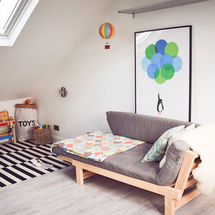 Design ideas for a medium sized contemporary gender neutral nursery in Essex with white walls and vinyl flooring.