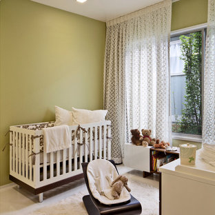 Inspiration for a contemporary gender-neutral nursery in San Francisco with green walls.