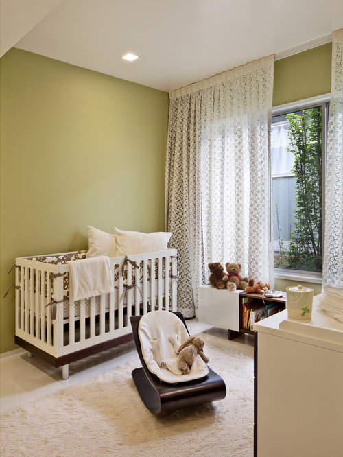 Example of a midcentury modern gender-neutral nursery design in San  Francisco with green walls