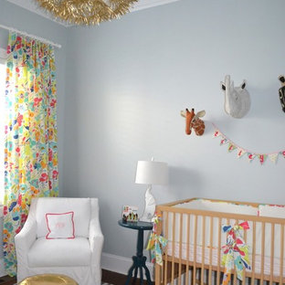 Photo of a traditional nursery for girls in Wilmington with grey walls and dark hardwood floors.