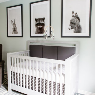 Design ideas for a mid-sized modern nursery for boys in Toronto with green walls and light hardwood floors.