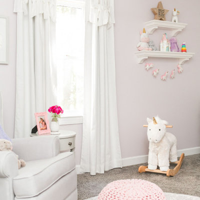 Nursery - mid-sized transitional girl carpeted and gray floor nursery idea in Raleigh with pink walls