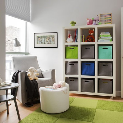 Inspiration for a mid-sized contemporary gender-neutral light wood floor nursery remodel in Boston with white walls