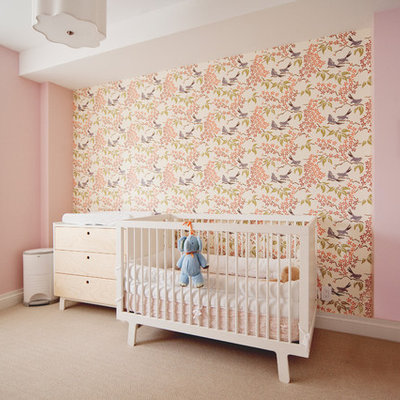 Nursery - mid-sized transitional girl carpeted and beige floor nursery idea in New York with pink walls
