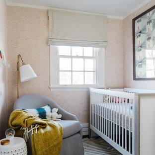 Trendy gender-neutral nursery photo in Boston with orange walls