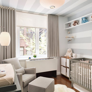 Inspiration for a contemporary gender-neutral dark wood floor nursery remodel in New York with gray walls