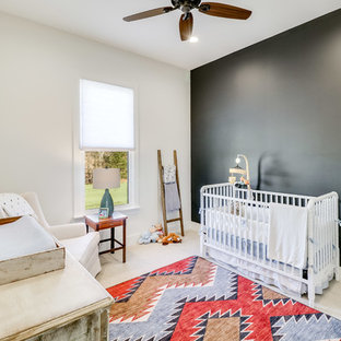 This is an example of a medium sized farmhouse gender neutral nursery in Jackson with white walls, carpet and beige floors.