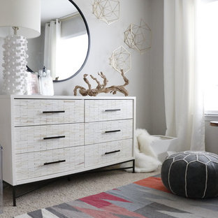 Nursery - small modern girl carpeted and gray floor nursery idea in St Louis with gray walls