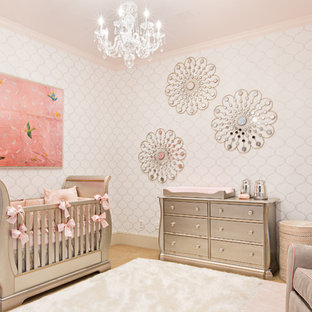 Medium sized traditional nursery for girls in Other with white walls and carpet.