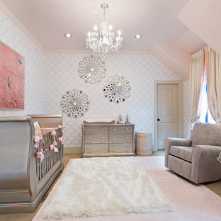 This is an example of a medium sized traditional nursery for girls in Other with white walls and carpet.