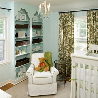 Design ideas for a classic gender neutral nursery in Minneapolis with blue walls and medium hardwood flooring.