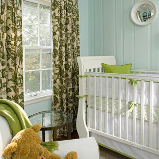 Traditional gender neutral nursery in Minneapolis with blue walls and carpet.