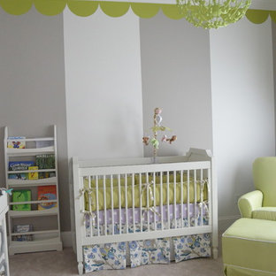 Medium sized bohemian gender neutral nursery in Charlotte with multi-coloured walls and carpet.