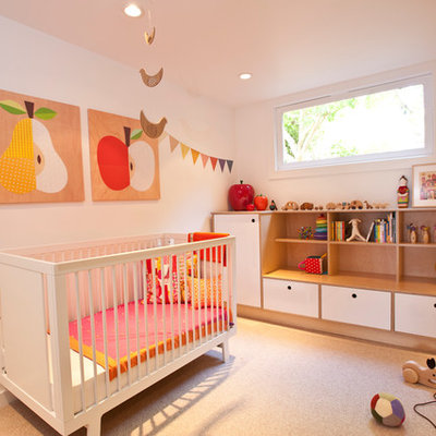 Inspiration for a scandinavian girl carpeted nursery remodel in San Francisco with white walls