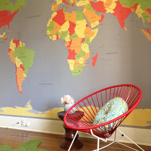 Contemporary gender neutral nursery in Orange County with multi-coloured walls and medium hardwood flooring.