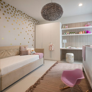 Inspiration for a contemporary girl nursery remodel in Miami with gray walls