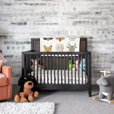 Nursery - mid-sized contemporary gender-neutral carpeted and gray floor nursery idea in Portland with multicolored walls