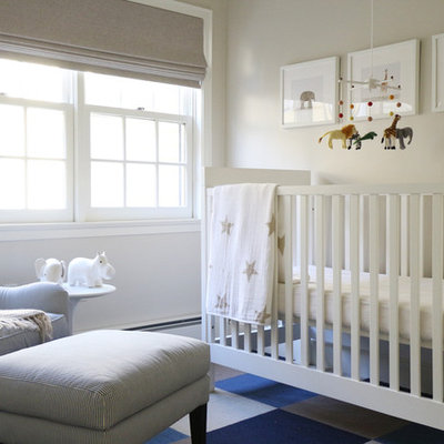 Transitional gender-neutral nursery photo in Los Angeles with beige walls