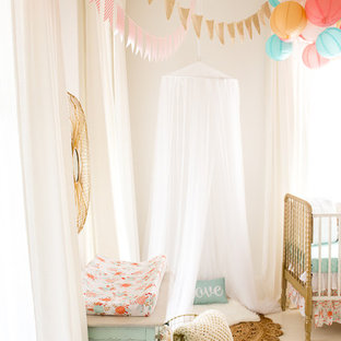 Inspiration for a mid-sized shabby-chic style girl painted wood floor nursery remodel in Atlanta with white walls