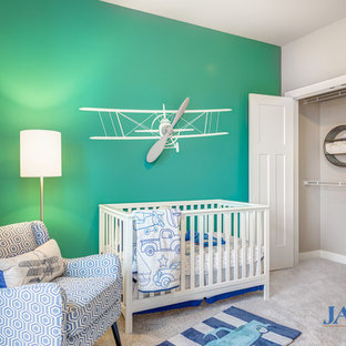 Mid-sized arts and crafts boy carpeted nursery photo in Other with blue walls