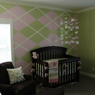 Design ideas for a medium sized classic nursery for girls in Other with green walls and carpet.