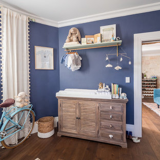 Design ideas for a mid-sized transitional nursery for boys in Sydney with blue walls, dark hardwood floors and brown floor.