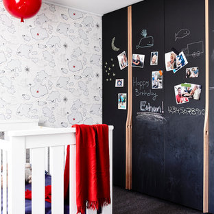 Example of a small trendy gender-neutral gray floor nursery design in Melbourne with multicolored walls