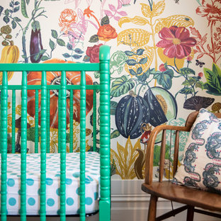 Inspiration for a large mediterranean nursery for girls in Melbourne with multi-coloured walls and medium hardwood flooring.