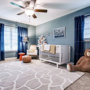 This is an example of a medium sized eclectic gender neutral nursery in Dallas with blue walls and carpet.