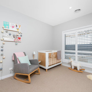 Photo of a contemporary gender-neutral nursery in Canberra - Queanbeyan with grey walls, carpet and beige floor.