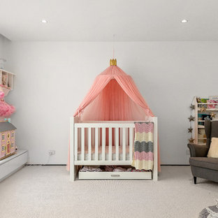 Inspiration for a mid-sized transitional nursery for girls in Melbourne with white walls, carpet and white floor.