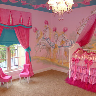 Photo of a bohemian nursery for girls in Dallas with multi-coloured walls and carpet.