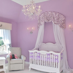 Design ideas for a large traditional nursery for girls in New York with purple walls and carpet.