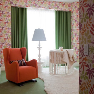 Inspiration for a contemporary nursery for girls in New York with multi-coloured walls, carpet and green floors.