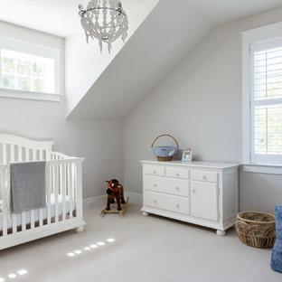 Mid-sized elegant boy carpeted and beige floor nursery photo in Charleston with beige walls