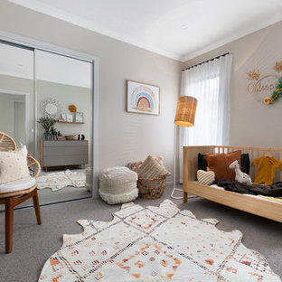 This is an example of a contemporary nursery in Other with grey walls, carpet and grey floor.