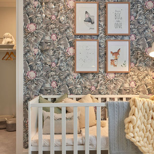 Photo of a medium sized traditional nursery for girls in Melbourne with grey walls, carpet, grey floors and wallpapered walls.