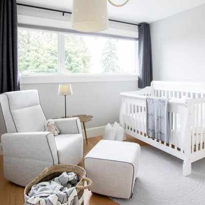 Inspiration for a mid-sized transitional boy beige floor nursery remodel in Vancouver with white walls