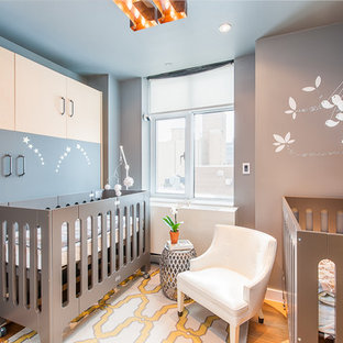 Inspiration for a small bohemian gender neutral nursery in San Francisco with grey walls and light hardwood flooring.