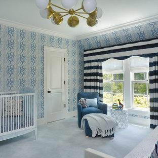 Foto de habitación de bebé niño clásica renovada con paredes azules, moqueta y suelo azul