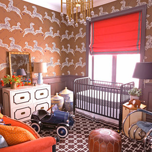 This is an example of a bohemian nursery for boys in Chicago with brown walls and carpet.