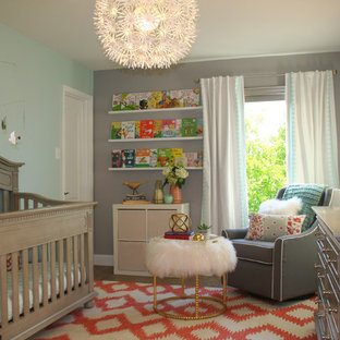 Inspiration for a mid-sized eclectic girl dark wood floor nursery remodel in Austin with gray walls