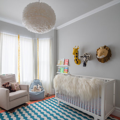 Transitional gender-neutral blue floor nursery photo in San Francisco with gray walls