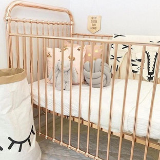 Design ideas for a scandi nursery for girls in Los Angeles with beige walls and carpet.