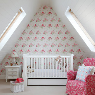 Traditional nursery for girls in Kent with multi-coloured walls, carpet and beige floors.